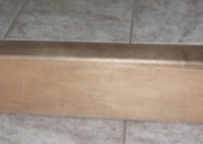 photos of a single step with wooden ledge as viewed with low vision
